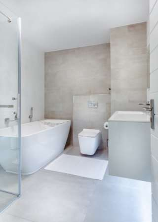 custom bathroom renovation with stand-up shower and bath tub